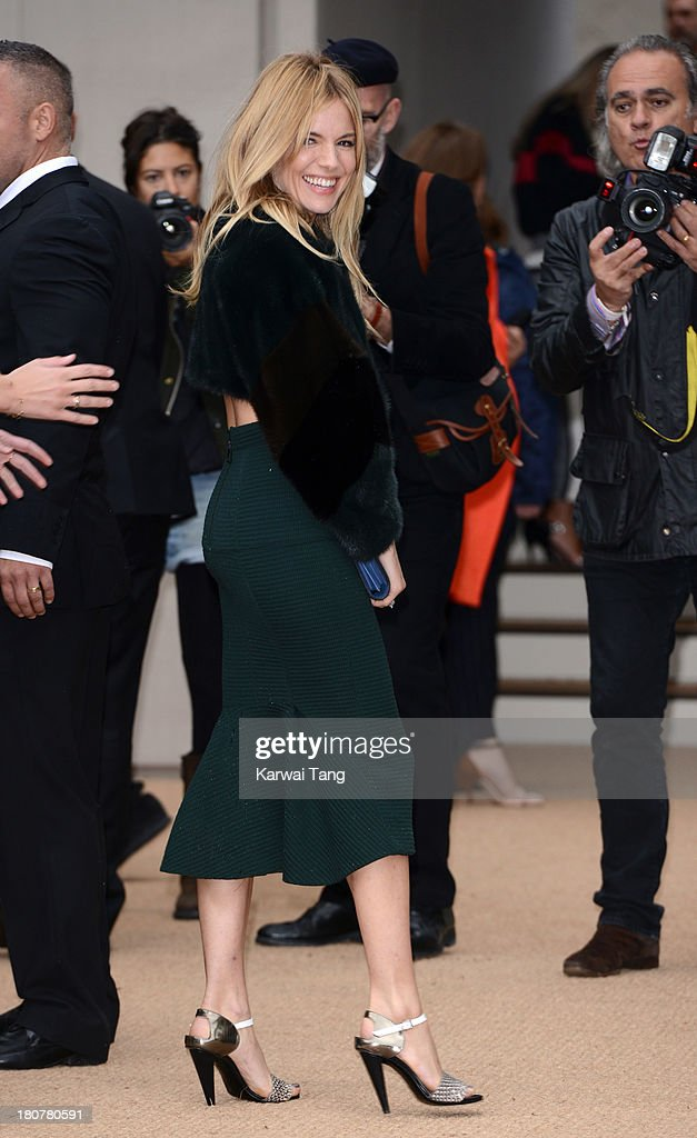 <a gi-track='captionPersonalityLinkClicked' href=/galleries/search?phrase=Sienna+Miller&family=editorial&specificpeople=171883 ng-click='$event.stopPropagation()'>Sienna Miller</a> attends the Burberry Prorsum show during London Fashion Week SS14 at Kensington Gardens on September 16, 2013 in London, England.