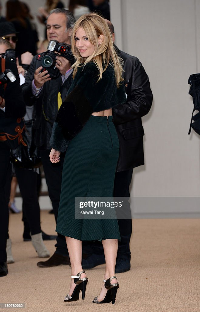 Sienna Miller attends the Burberry Prorsum show during London Fashion Week SS14 at Kensington Gardens on September 16, 2013 in London, England.