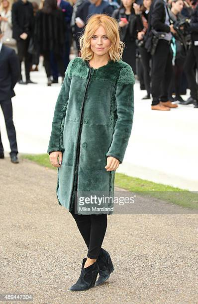 Sienna Miller attends the Burberry Prorsum show during London Fashion Week Spring/Summer 2016/17 on September 21 2015 in London England