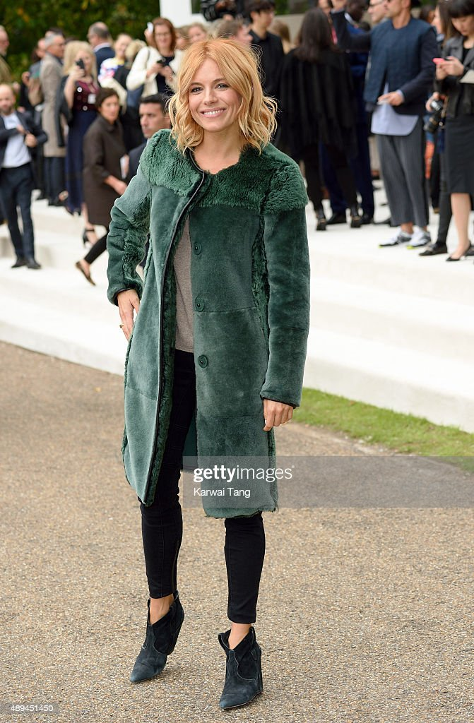 Sienna Miller attends the Burberry Prorsum show during London Fashion Week Spring/Summer 2016/17 at Kensington Gardens on September 21, 2015 in London, England.