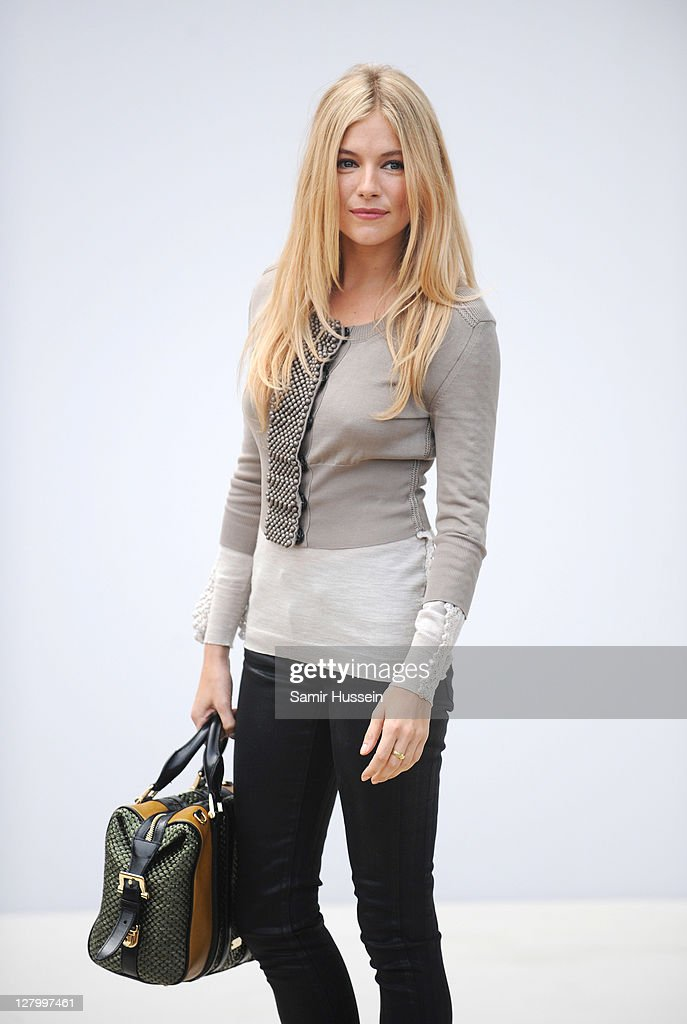 <a gi-track='captionPersonalityLinkClicked' href=/galleries/search?phrase=Sienna+Miller&family=editorial&specificpeople=171883 ng-click='$event.stopPropagation()'>Sienna Miller</a> attends the Burberry Spring Summer 2012 Womenswear Show at Kensington Gardens on September 19, 2011 in London, England.