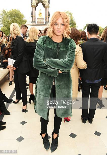 Sienna Miller attends the Burberry Womenswear Spring/Summer 2016 show during London Fashion Week at Kensington Gardens on September 21 2015 in London...