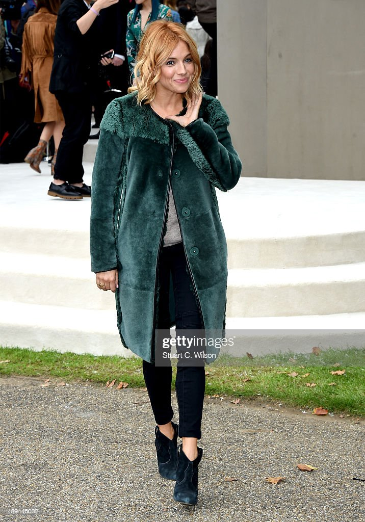 Sienna Miller attends the Burberry Womenswear Spring/Summer 2016 show during London Fashion Week at Kensington Gardens on September 21, 2015 in London, England.