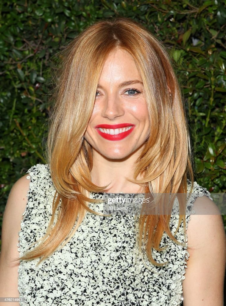 Sienna Miller attends the Chanel Charles Finch Pre-Oscar Dinner held at Madeo Restaurant on March 1, 2014 in Los Angeles, California.
