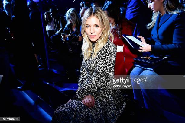 Sienna Miller attends the Christian Dior show as part of the Paris Fashion Week Womenswear Fall/Winter 2017/2018 on March 3 2017 in Paris France