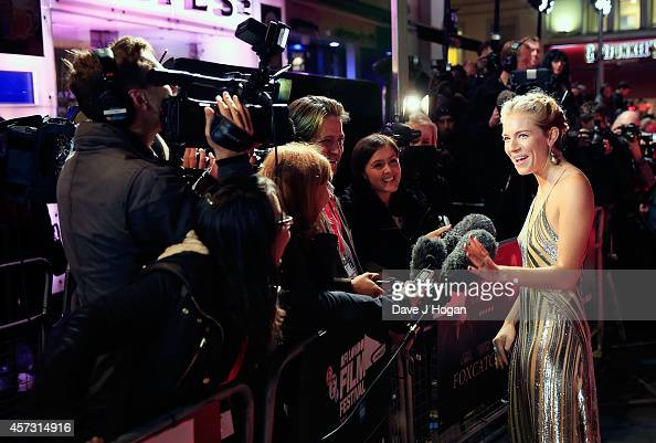 Sienna Miller attends the VIP arrivals of the Amex Gala premiere for 'Foxcatcher' during the 58th BFI London Film Festival at Odeon Leicester Square...
