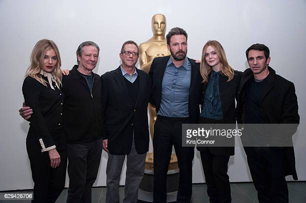 Sienna Miller Chris Cooper Marshall Fine Ben Affleck Elle Fanning and Chris Messina attends an official academy screening of LIVE BY NIGHT hosted by...