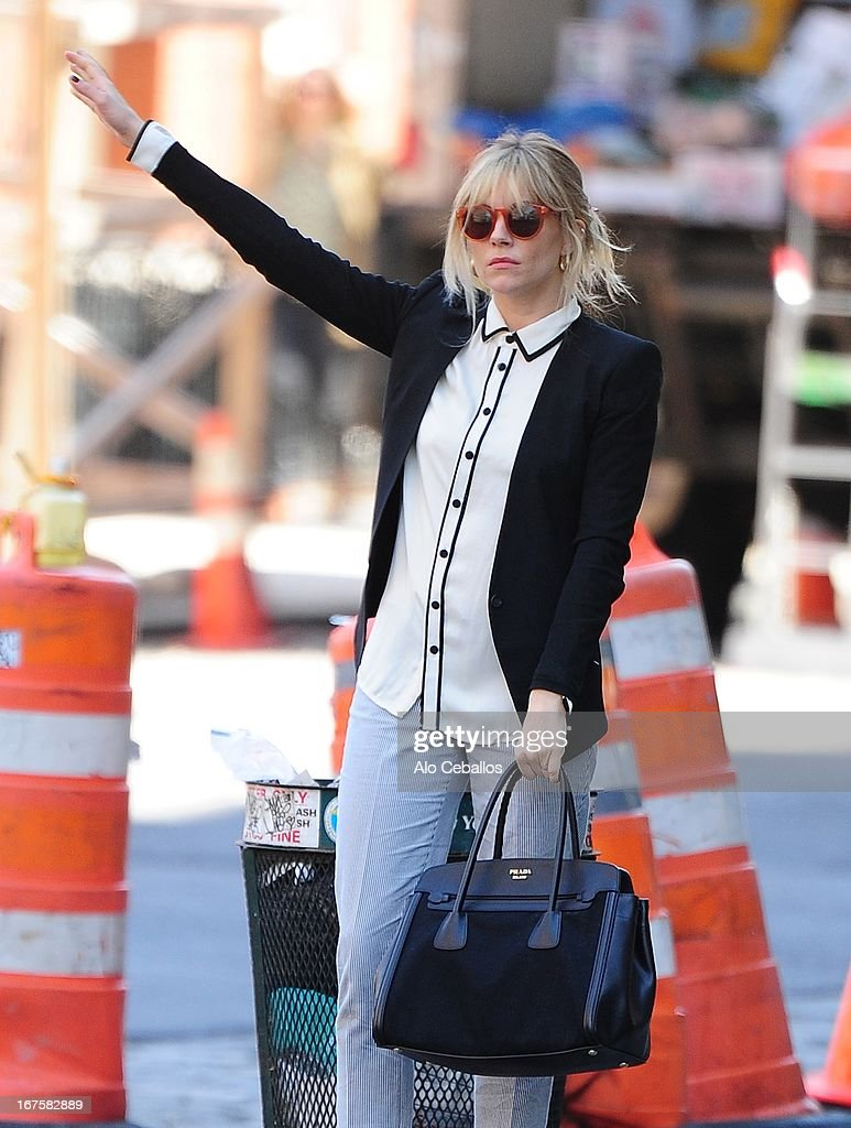 <a gi-track='captionPersonalityLinkClicked' href=/galleries/search?phrase=Sienna+Miller&family=editorial&specificpeople=171883 ng-click='$event.stopPropagation()'>Sienna Miller</a> is seen in the West Village on April 26, 2013 in New York City.