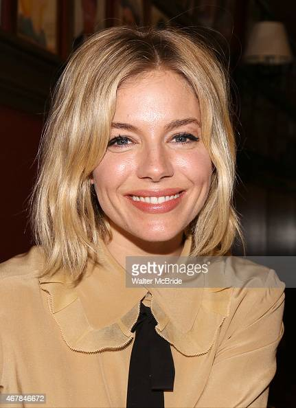 Sienna Miller joins the wall of fame as she attends the unveiling of the Sienna Miller Caricature at Sardi's Restaurant on March 27 2015 in New York...