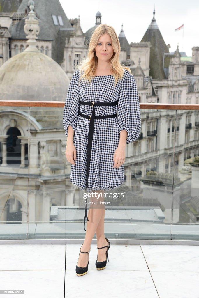 Sienna Miller poses at a photocall for 'The Lost City Of Z' at Corinthia London on February 16, 2017 in London, England.