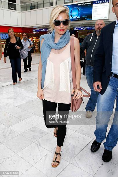 Sienna Miller spotted at Nice airport wearing the new Coccinelle Arlettis Bag on May 25 2015 in Nice France
