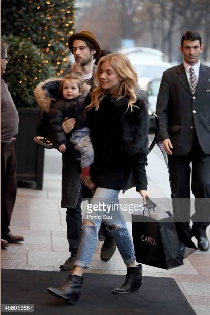 Sienna Miller Tom Sturridge and daughter Marlowe Sturridge are seen on December 13 2013 in Paris France