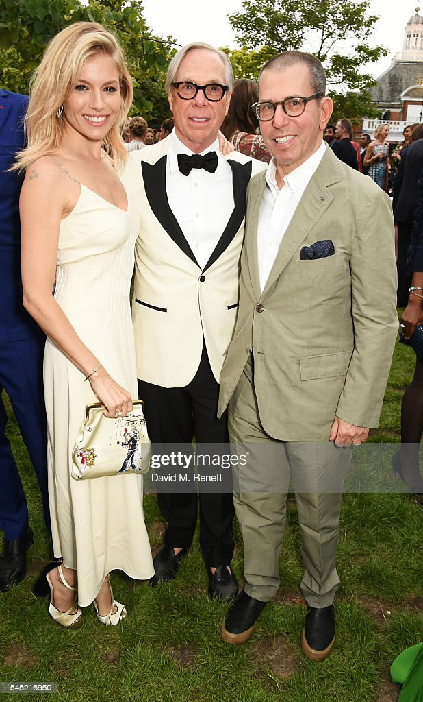 Sienna Miller Tommy Hilfiger and Jonathan Newhouse attend The Serpentine Summer Party cohosted by Tommy Hilfiger on July 6 2016 in London England