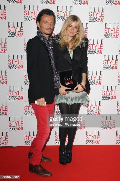 Sienna Miller with the ELLE Style Icon award poses with Matthew Williamson at the ELLE Style Awards at Big Sky London 2931 Brewery Street London at...