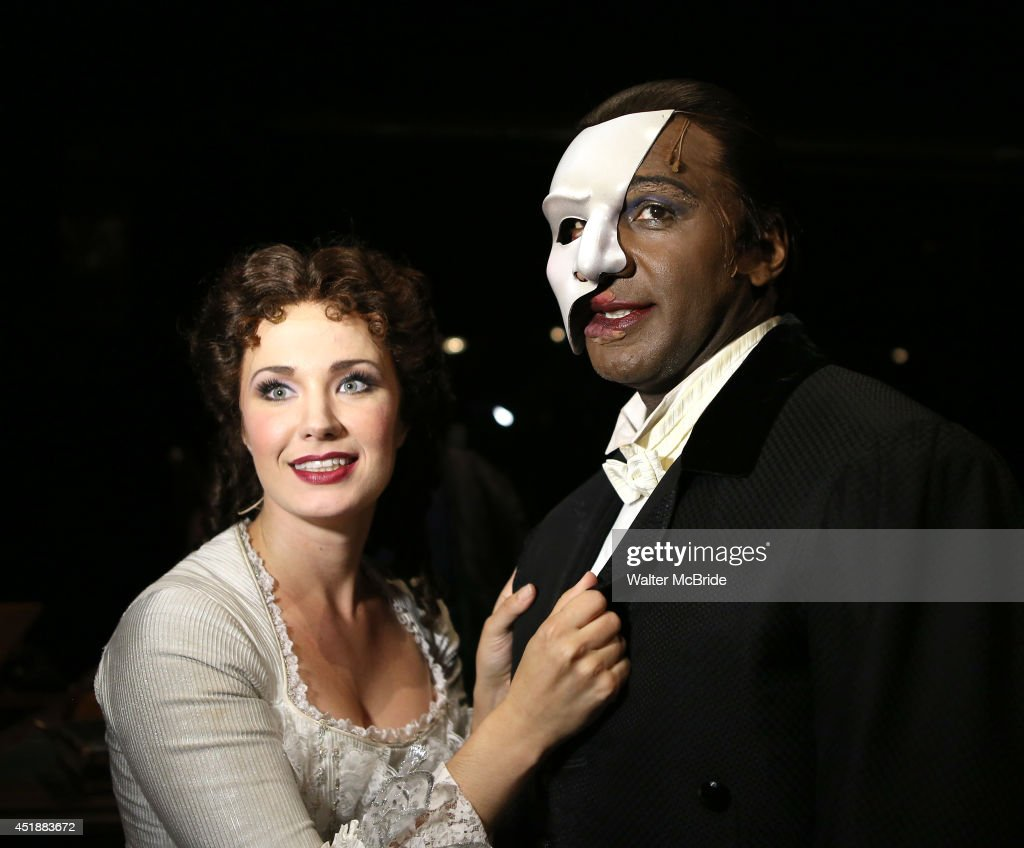 Sierra Boggess and Norm Lewis backstage at the 'Phantom Of The Opera' 11,000th Broadway Celebration at the Majestic Theatre on July 8, 2014 in New York City.