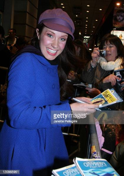 Sierra Boggess signs autographs at the reopening of 'The Little Mermaid' on Broadway after the Stagehands' Strike at LuntFontanne theater on November...