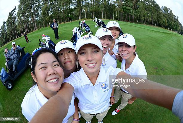 Sierra Brooks of Team USA asks to borrow a camera for a Selfie with her team mates Amy Lee Andrea Lee Kristen Gillman Bethany Wu and Hannah...