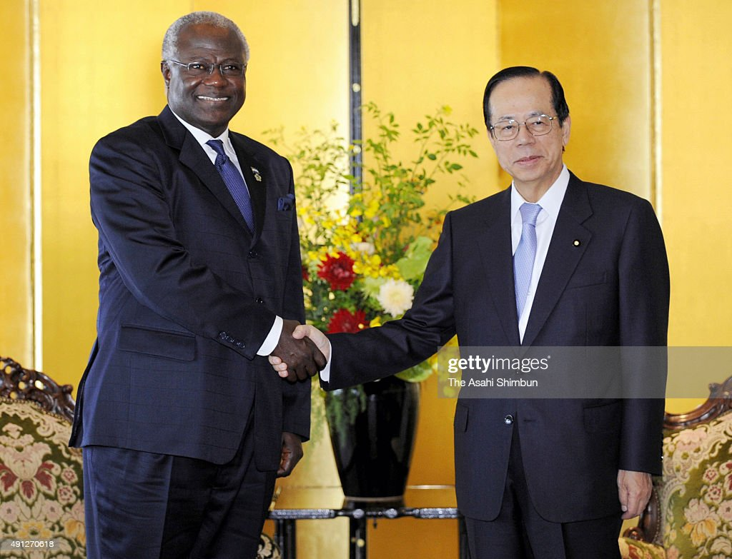Sierra Leone President <a gi-track='captionPersonalityLinkClicked' href=/galleries/search?phrase=Ernest+Bai+Koroma&family=editorial&specificpeople=4447998 ng-click='$event.stopPropagation()'>Ernest Bai Koroma</a> (L) and Japanese Prime Minister <a gi-track='captionPersonalityLinkClicked' href=/galleries/search?phrase=Yasuo+Fukuda&family=editorial&specificpeople=2664316 ng-click='$event.stopPropagation()'>Yasuo Fukuda</a> (R) shakes hands during their meeting on the sidelines of the Tokyo International Conference on African Development (TICAD IV) at Pacifico Yokohama on May 29, 2008 in Yokohama, Kanagawa, Japan.