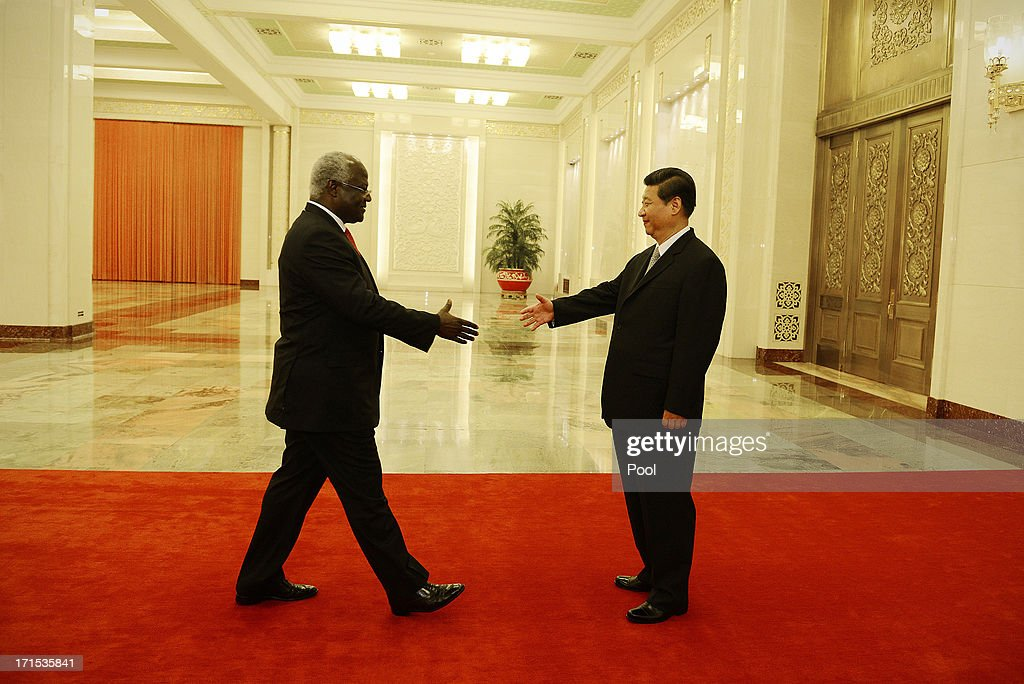 Sierra Leone President <a gi-track='captionPersonalityLinkClicked' href=/galleries/search?phrase=Ernest+Bai+Koroma&family=editorial&specificpeople=4447998 ng-click='$event.stopPropagation()'>Ernest Bai Koroma</a> meets with Chinese President <a gi-track='captionPersonalityLinkClicked' href=/galleries/search?phrase=Xi+Jinping&family=editorial&specificpeople=2598986 ng-click='$event.stopPropagation()'>Xi Jinping</a> (C, L) at the Great Hall of the People on Jun 26, 2013 in Beijing, China. <a gi-track='captionPersonalityLinkClicked' href=/galleries/search?phrase=Ernest+Bai+Koroma&family=editorial&specificpeople=4447998 ng-click='$event.stopPropagation()'>Ernest Bai Koroma</a> is on a visit to China from Jun 24.