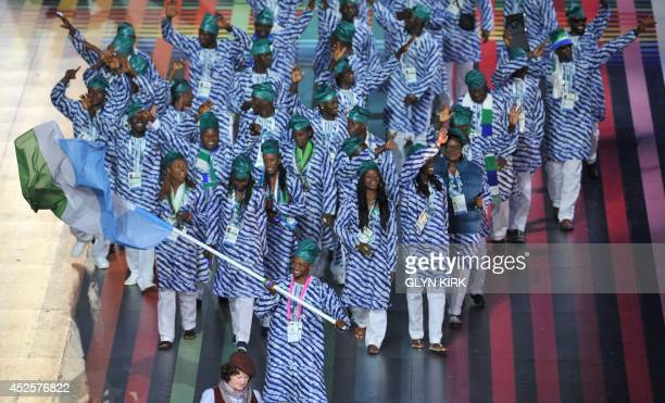 Sierra Leone's flagbearer James Fayia leads the delegation during the opening ceremony of the 2014 Commonwealth Games at Celtic Park in Glasgow on...