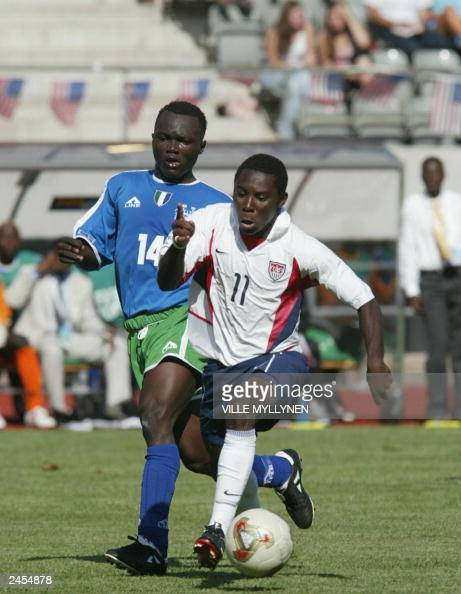 Sierra Leone's Lansana Bayo and US Freddy Adu fights for the ball in Lahti 17 August 2003 as part of the U17 World Soccer Championships16 teams are...