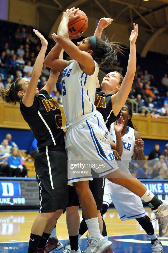 Sierra Moore #5 of the Duke Blue Devils goes to the hoop against Haley D'Angelo #5 of the Iona Gaels at Cameron Indoor Stadium on November 18, 2012 in Durham, North Carolina. Duke defeated Iona 100-31.