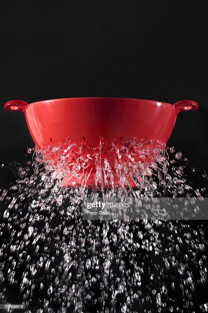 sieve leaking water : Stock Photo
