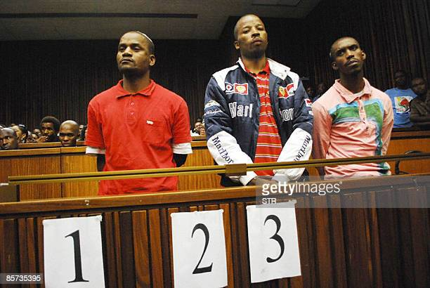 Sifiso Mhlanga Julio Shirindza and Mbuti Mabe stand before Judge Seun Moshidi unseenduring the handing down of judgement in the South Gauteng High...