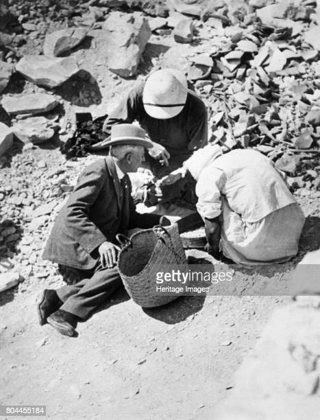 Sifting the dust from the floor of the Tomb of Tutankhamun Valley of the Kings Egypt 1922 Sir Charles Cust the King's Equerry with Mr Callender The...