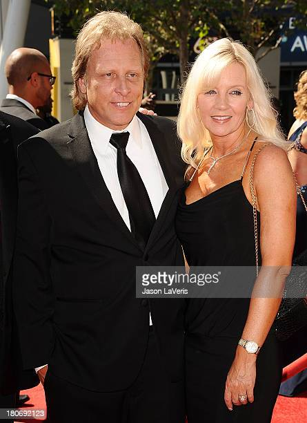 Sig Hansen and June Hansen attends the 2013 Creative Arts Emmy Awards at Nokia Theatre LA Live on September 15 2013 in Los Angeles California