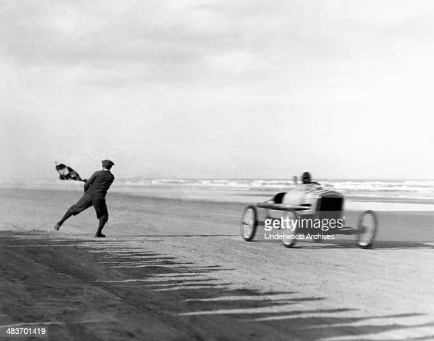 Sig Haugdahl gets the checkered flag as he wins the opening event of the New Year's Day Races in his Daytona Cyclone race car Daytona Beach Florida...