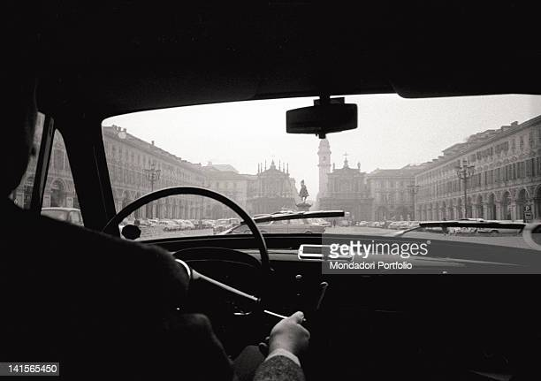 A sight of Piazza San Carlo from the passenger compartment of a FIAT Cinquecento The Turinese automobile car team has overcome the crisis of the year...