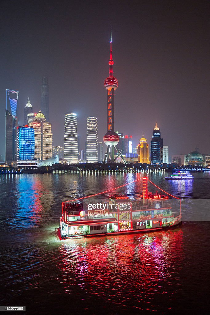 Sightseeing boat and Pudong Skyline at night