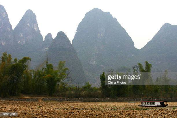 A sightseeing boat lies on the dry riverbed of Lijiang River on January 12 2007 in Guilin of Guangxi Zhuang Autonomous Region southern China Guilin...