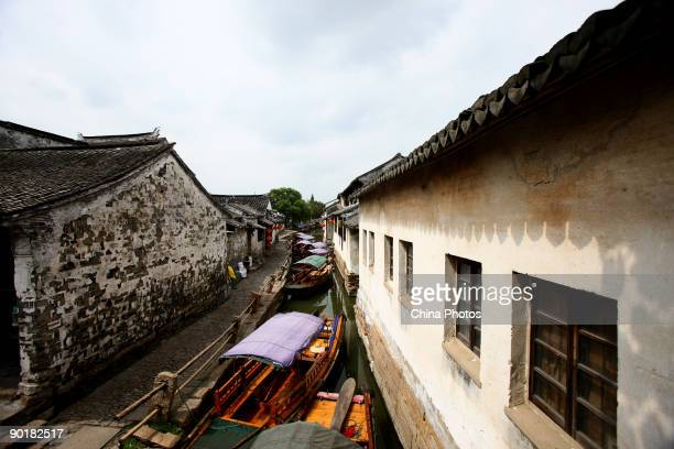 Sightseeing boats line up on a canal on August 29 2009 in Zhouzhuang Town of Kunshan City Jiangsu Province China Zhouzhuang first built around 1000...