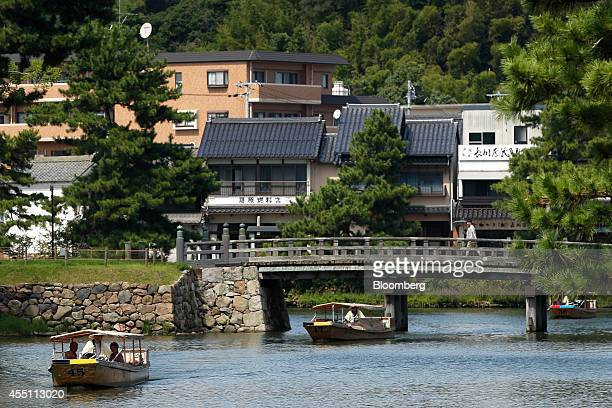 Sightseeing boats sail through a castle moat around Matsue Castle in Matsue Shimane Prefecture on Tuesday Sept 9 2014 In Matsue Japanese Tennis...