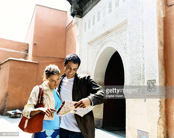 Sightseeing Couple Reading a Map, Marrakesh, Morocco