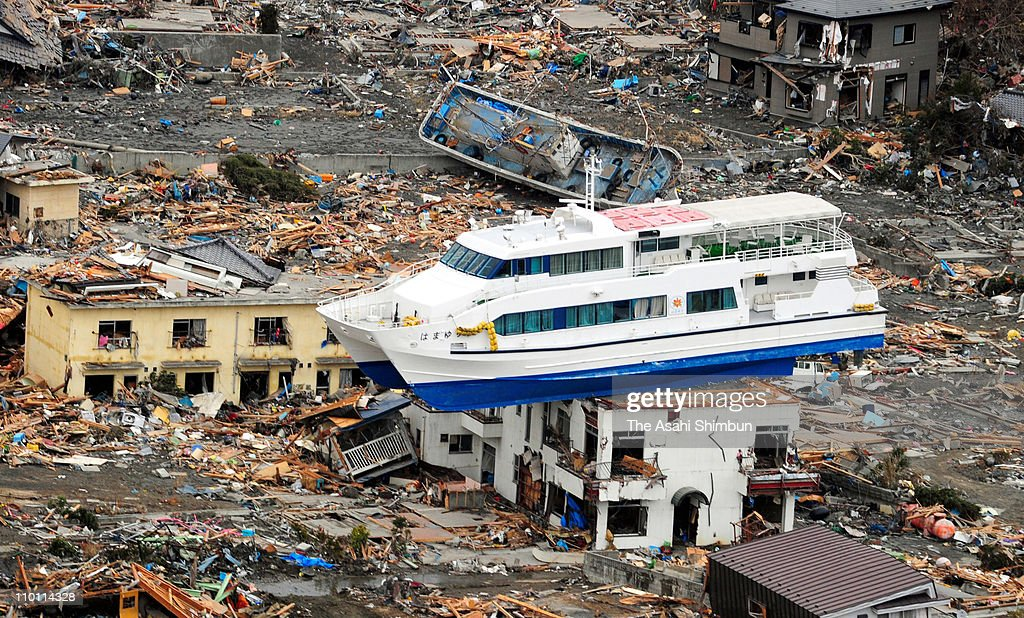 A sightseeing ship is washed onto 2-story high building after an 9.0 magnitude strong earthquake struck on March 11 off the coast of north-eastern Japan, on March 15, 2011 in Otsuchi, Iwate, Japan. The quake struck offshore at 2:46pm local time, triggering a tsunami wave of up to 10 metres which engulfed large parts of north-eastern Japan. The death toll is currently unknown, with fears that the current hundreds dead may well run into thousands.