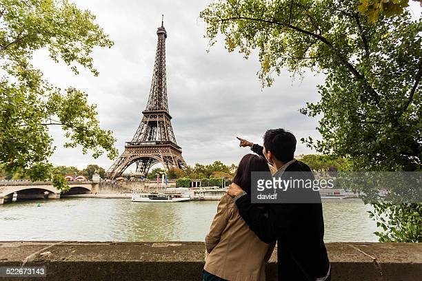 Sightseeing Young Asian couple on romantic vacation in Paris