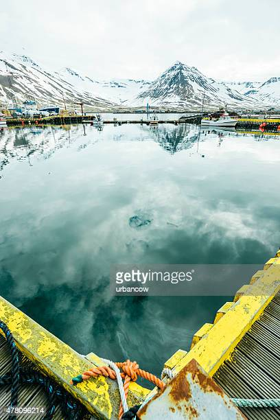 Siglufjörður harbour, still water with mountains, North-Central Iceland