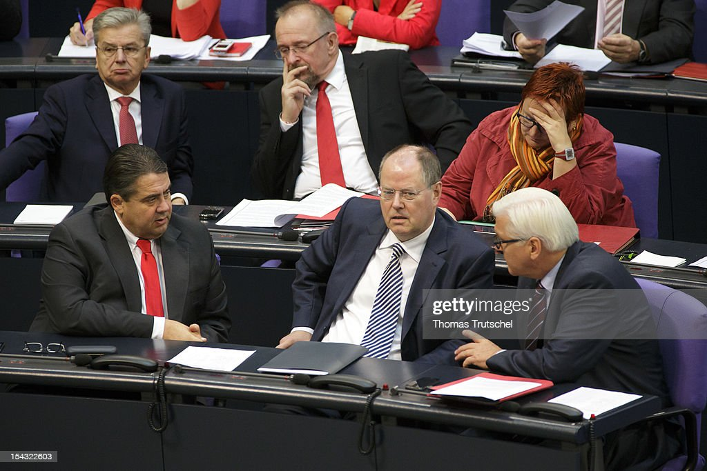 <a gi-track='captionPersonalityLinkClicked' href=/galleries/search?phrase=Sigmar+Gabriel&family=editorial&specificpeople=543927 ng-click='$event.stopPropagation()'>Sigmar Gabriel</a>, Chairman of German Social Democrats (SPD), <a gi-track='captionPersonalityLinkClicked' href=/galleries/search?phrase=Peer+Steinbrueck&family=editorial&specificpeople=209110 ng-click='$event.stopPropagation()'>Peer Steinbrueck</a>, Chancellor candidate of the German Social Democrats (SPD) for the 2013 general election , and SPD Bundestag faction leader <a gi-track='captionPersonalityLinkClicked' href=/galleries/search?phrase=Frank-Walter+Steinmeier&family=editorial&specificpeople=603500 ng-click='$event.stopPropagation()'>Frank-Walter Steinmeier</a> sit at Reichstag, the seat of the German Parliament (Bundestag), on October 18, 2012 in Berlin, Germany. European Union leaders are expected to focus on economic and monetary policies as they gather for the two-day Autumn meeting starting today in Brussels.