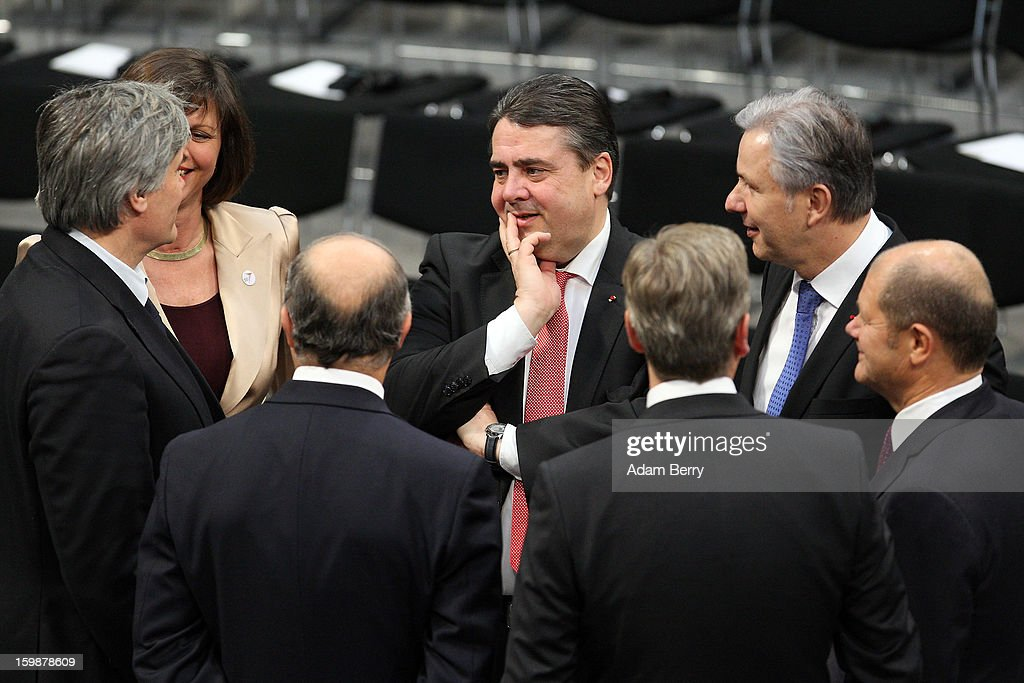 Sigmar Gabriel (C), chairman of the German Social Democrats (SPD), and Berlin Mayor Klaus Wowereit (R) arrive for a joint session of the German Bundestag and French Assemblee Nationale parliaments in the Reichstag building during the 50th anniversary celebration of the Elysee Treaty on January 22, 2013 in Berlin, Germany. The treaty, concluded in 1963 by Charles de Gaulle and Konrad Adenauer in the Elysee Palace in Paris, set a new tone of reconciliation between France and Germany, and called for consultations between the two countries to come to a common stance on policies affecting the most important partners in Europe as well as the rest of the region. Since its establishment, the document for improved bilateral relations has been seen by many as the driving force behind European integration.