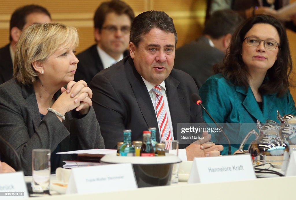 <a gi-track='captionPersonalityLinkClicked' href=/galleries/search?phrase=Sigmar+Gabriel&family=editorial&specificpeople=543927 ng-click='$event.stopPropagation()'>Sigmar Gabriel</a> (C), Chairman of the German Social Democrats (SPD) and flanked by leading SPD members <a gi-track='captionPersonalityLinkClicked' href=/galleries/search?phrase=Hannelore+Kraft&family=editorial&specificpeople=4643983 ng-click='$event.stopPropagation()'>Hannelore Kraft</a> (L) and <a gi-track='captionPersonalityLinkClicked' href=/galleries/search?phrase=Andrea+Nahles&family=editorial&specificpeople=822618 ng-click='$event.stopPropagation()'>Andrea Nahles</a>, attends the second round of coalition negotiations with the German Christian Democrats (CDU) and the Bavarian Christian Democrats (CSU) on October 30, 2013 in Berlin, Germany. The SPD, CDU and CSU are seeking to create a coaltion government following German elections in September.