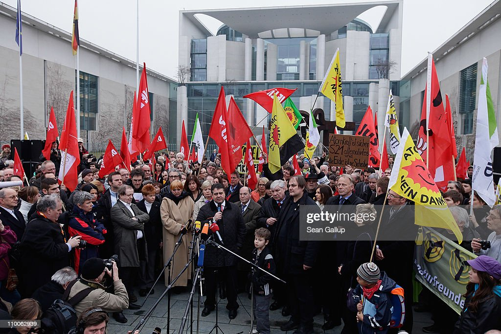 Sigmar Gabriel, Chairman of the German Social Democrats (SPD), and other leading German opposition politicians speak during an anti-nuclear demonstration in front of the Chancellery on March 14, 2011 in Berlin, Germany. Thousands of anti-nuclear demonstrators, in reaction to the dramatic situation at the Fukushima nuclear facility in Japan, gathered in a coordinated effort in cities across Germany to protest against the government-granted extension of the operational lives of Germany's older nuclear power plants. The debate over the safety of nuclear energy has been reignited worldwide following the earthquake and tsunami in Japan that severely damaged the Fukushima plant and where workers are desperately seeking to prevent a nuclear meltdown.