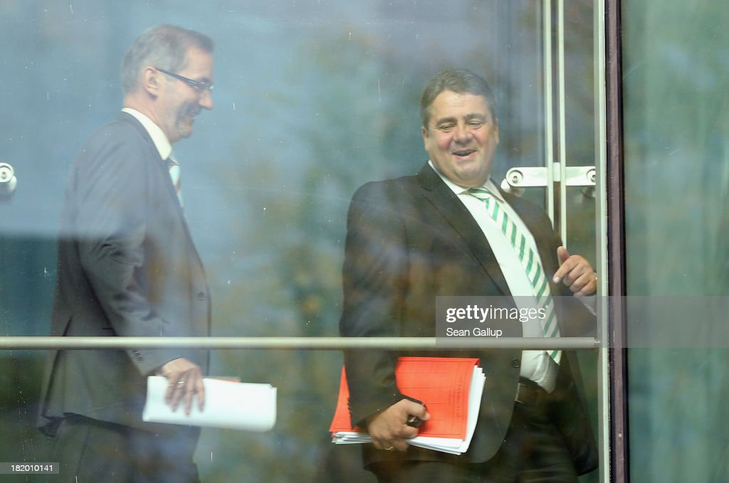 <a gi-track='captionPersonalityLinkClicked' href=/galleries/search?phrase=Sigmar+Gabriel&family=editorial&specificpeople=543927 ng-click='$event.stopPropagation()'>Sigmar Gabriel</a> (R), Chairman of the German Social Democrats (SPD), and SPD member <a gi-track='captionPersonalityLinkClicked' href=/galleries/search?phrase=Matthias+Platzeck&family=editorial&specificpeople=605525 ng-click='$event.stopPropagation()'>Matthias Platzeck</a> walk across a glassed-in bridge at SPD headquarters to a conference of 200 leading SPD members on September 27, 2013 in Berlin, Germany. The SPD is mulling options for entering into a possible coalition government with the German Christian Democrats (CDU) following recent federal elections that gave the CDU a strong win but still in need of a coalition partner.