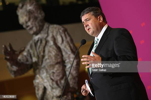 Sigmar Gabriel Chairman of the German Social Democrats speaks to the media next to a statue of former German Chancellor Willy Brandt at SPD...