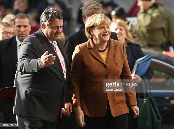 Sigmar Gabriel Chairman of the German Social Democrats welcomes German Chancellor and Chairwoman of the German Christian Democrats Angela Merkel at...