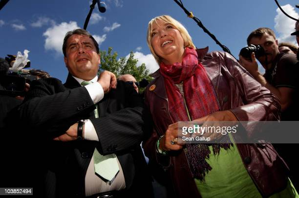 Sigmar Gabriel Chairman of the opposition German Social Democrats and Claudia Roth coChairwoman of the German Greens party join activists at an...
