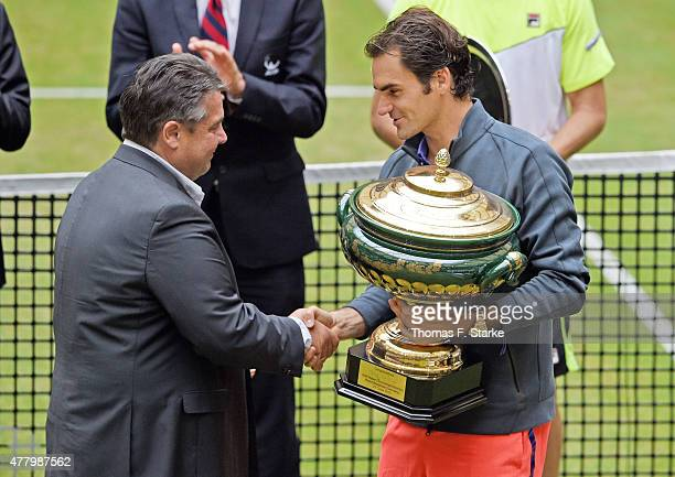 Sigmar Gabriel congratulates Roger Federer of Switzerland after winning the final day of the Gerry Weber Open at Gerry Weber Stadium on June 21 2015...