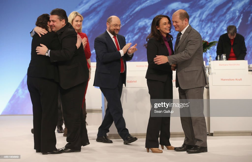 Sigmar Gabriel (L), German Vice Chancellor and Chairman of the German Social Democrats (SPD), embraces outgoing SPD General Secretary Andrea Nahles as Olaf Scholz (R), Mayor of Hamburg, congratulates newly-elected SPD General Secretary Yasmin Fahimi shortly after Fahimi received 88.5% of the vote of delegates to become the new General Secretary of the German Social Democrats (SPD) during a federal congress of the SPD on January 26, 2014 in Berlin, Germany. The SPD is holding a federal congress to elect its European Parliament candidates as well as to chart its domestic political future. The SPD is the junior member of the new German coalition government.